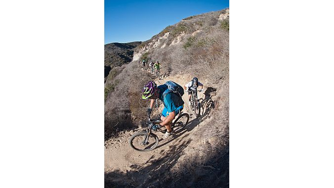 Trials and mountain bike legend Hans Rey escorts Crankbrothers employees and a handful of cycling journalists on a ride to test out new product in the company's Laguna Beach back yard.