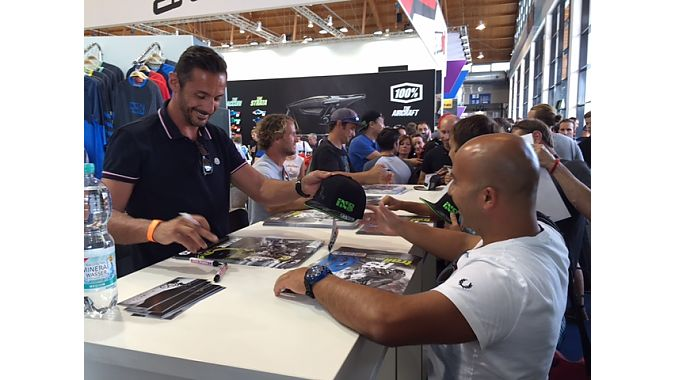 Fans line up for autographs from Cedric Gracia, Richie Schley and Darren Berrecloth at the iXS booth.