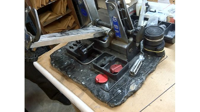 Wrench Science mounted one of its truing stands to a piece of granite.