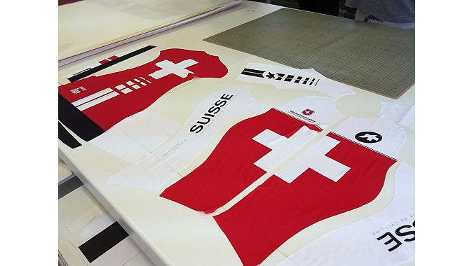Assos manufactures custom team kit and prototypes in Stabio. This sublimated fabric was being cut for the Swiss world championships team.