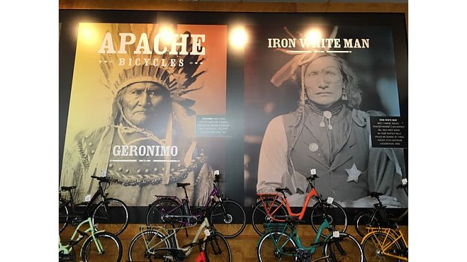 Giant wall-mounted Native American faces loomed over Apache's bike display.