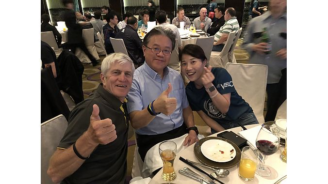 Specialized 's Bob Margevicius, Merida's president Michael Tseng and Velo's Ann Chen celebrate Velo's 40th year in business anniversary at Velo's traditional party before the TAIPEI Cycle show.