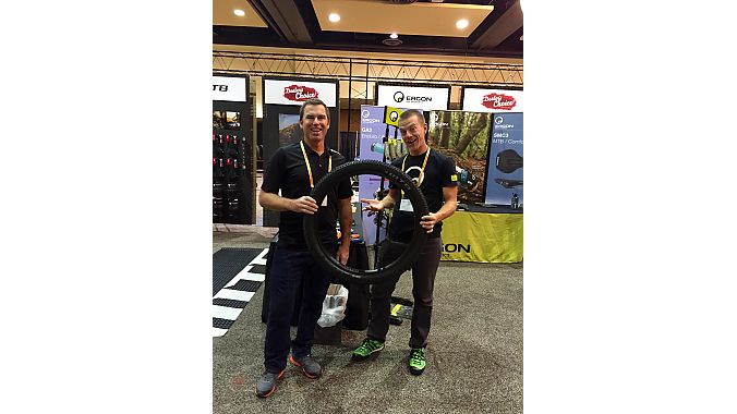 Booth bros Gary Gleason of WTB (left) and Jeff Kerkove of Ergon bond over tires in the showroom on Tuesday.