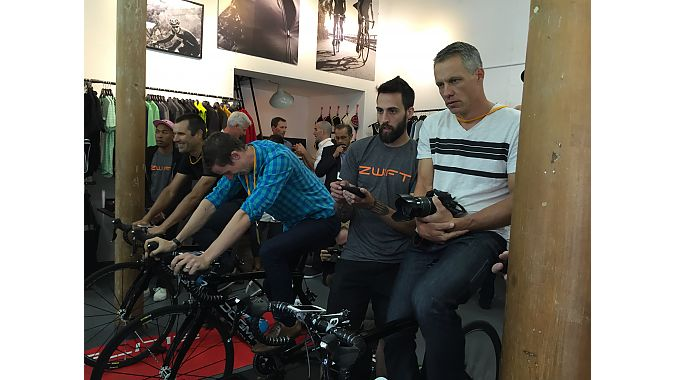 Neil Shirley of Road Bike Action, Caley Fretz of Velo, and Ben Delaney of BikeRadar.com demo Zwift's gaming based software at the Tuesday media event.