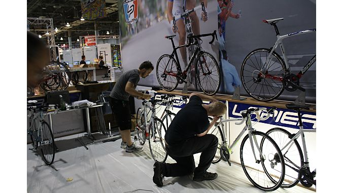 SBS employees set up and clean bikes for Wednesday's show opening. Photo: Steve Frothingham