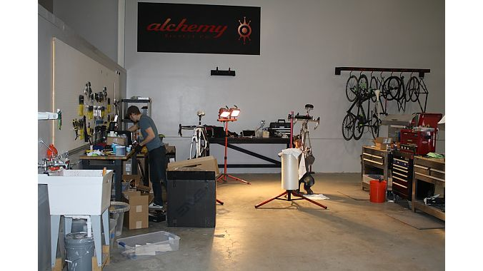 Chroma Fab shares space at Alchemy's headquarters. In this photo from Wednesday, a worker at Alchemy is prepping two bikes for NAHBS. Photo: Steve Frothingham