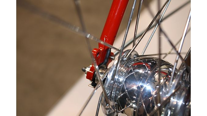 Harvey Cycles created internal wiring for a front generator hub, with the custom dropouts acting as the electrical connections.