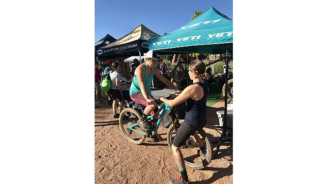 Yeti Cycling's Jamie Armitage sets up a Yeti Beti demo bike for Jenny McConnell, who lives in Girdwood, Alaska.