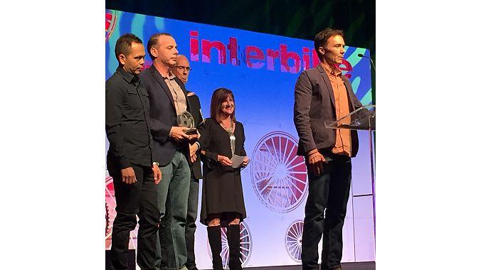 Boulder Cycle Sport accepts its award.