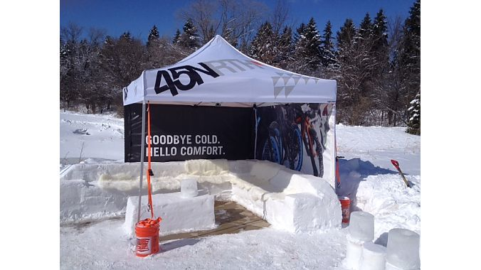 "Putting the chill in chillax: QBP house brand 45NRTH set up this ""ice couch"" lounge next to the fat bike track."