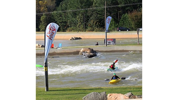 Kayakers paddle the manmade rapids at CycloFest host venue the U.S. National Whitewater Center.