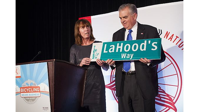 New York City Transportation Commissioner Janette Sadik-Khan presents outgoing U.S. Transportation Secretary Ray LaHood with an honorary NYC street sign.