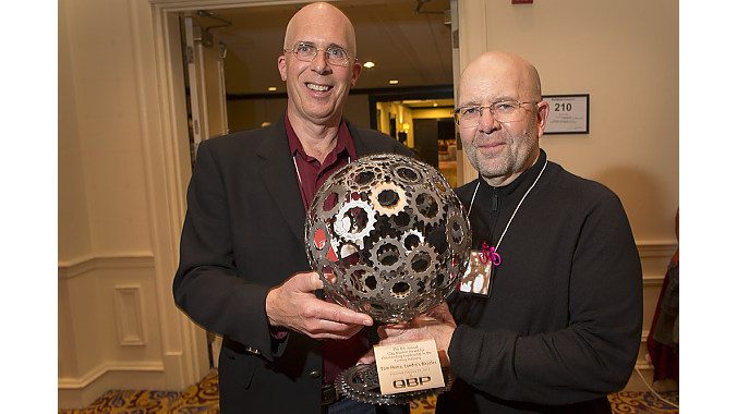 Tom Henry, of Boston's Landry's Bicycles, accepts the 2013 Clay Mankin Award for Outstanding Leadership in the Cycling Industry. The award was presented by Gary Sjoquist, QBP advocacy director.