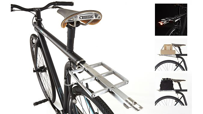 The NYC bikes has a spring-loaded retractable rear rack with integrated bungee and lighting.