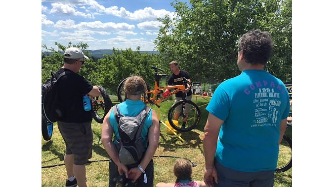Matthew Bracken of Pedro's, NEMBAfest's title sponsor, puts on a bike washing clinic for expo-goers.