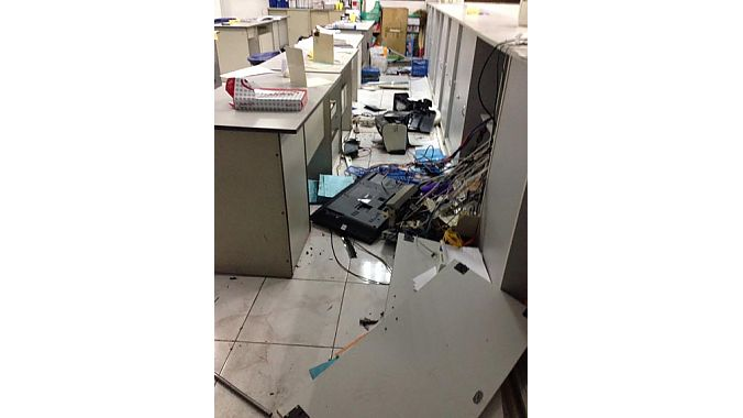 Rioters stole computers, smashed monitors and destroyed manufacturing equipment.