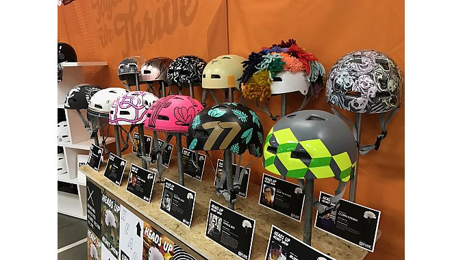 QBP staff spent weeks decorating helmets to show off its creativity in teh Heads Up helmet show at Frostbike's helmet showcase booth.