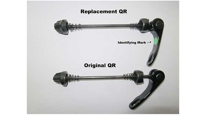 The levers closed, showing the green dot that identifies replacement levers.