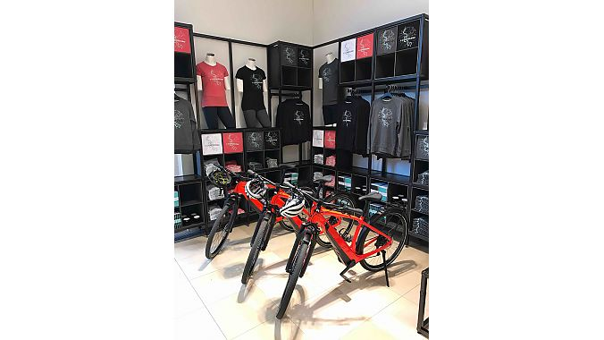 A selection of apparel and accessories, including 'Ride Dusseldorf' T-shirts and sweatshirts, is for sale at the store.