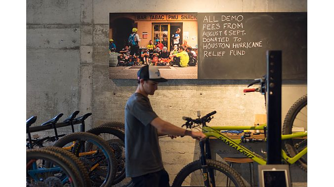 Santa Cruz's Kyle Bowman preps a demo bike whose fees will be donated to the employees of Sun & Ski who suffered damages in Hurricane Harvey. Photo byTyler Frasca.