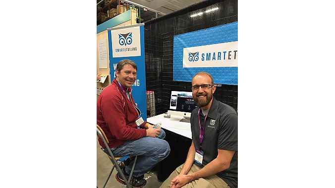 Retailer Kevin Gorman of Web Cyclery in Bend, Oregon, checks out SmartEtailing's new responsive websites with SmartEtailing's Ryan Atkinson.