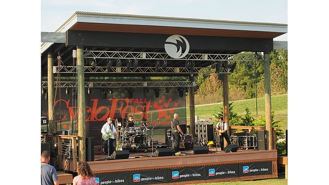 The band Graffiti, featuring DeFeet owner Shane Cooper, played a late-afternoon set Thursday on the Whitewater Center's River Jam Stage.