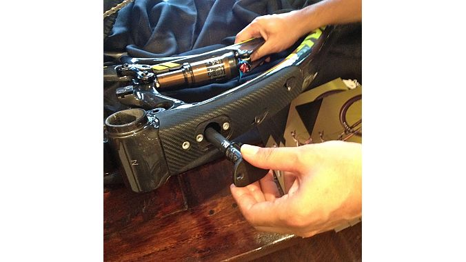 Pivot's Chris Cocalis demonstrates how to stow the Di2 battery inside the Mach 4 via the frame's downtube port.