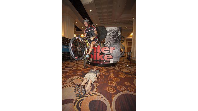 Trials rider Vittorio Brumotti hops over a show-goer.
