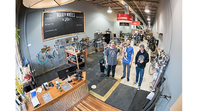 Wooden Wheels employees David Ferguson (left), Robbie Downward (center) and Chris Denney (right) reopened the store in a new location in early April.