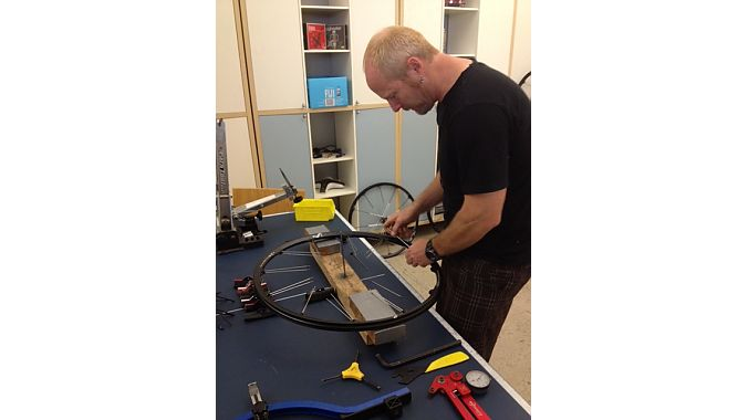 Product developer Tim Young demonstrates wheel assembly. All Crankbrothers wheels are 100 percent hand-built in Taiwan.