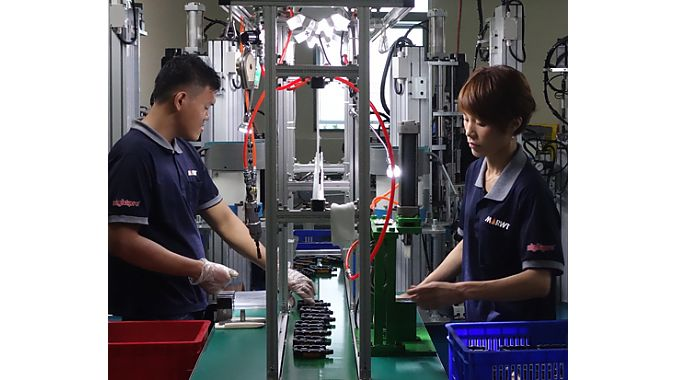 Workers assemble pedals, one of Marwi's largest product categories.