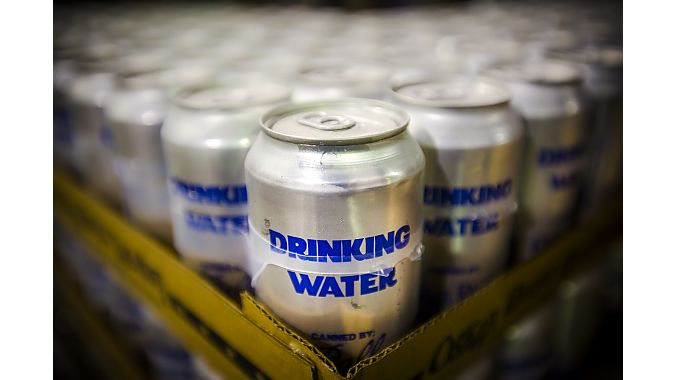 Colorado brewer Oskar Blues shut down beer canning to produce 220,000 cans of water for Houston.