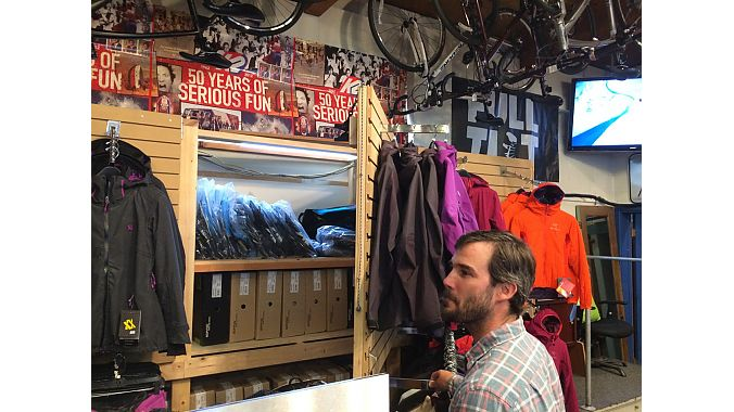At Alpine Hut, owner Kyle Fisher has the difficult task of maintaining a ski and bike shop virtually year round in a small space. One trick? Fisher built this ski boot storage area hidden behind a clothes display.