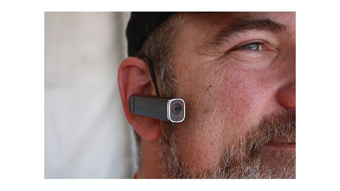 Jay Moore demonstrates the Looxcie, a tiny camera that can stream live video to your Facebook page. The camera sells for $149 to $179, depending on model, and weighs less than 30 grams. It can mount to a helmet, your ear or a hat brim.
