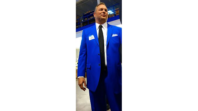 CEO Eric Hawkins greeted visitors in a new custom suit