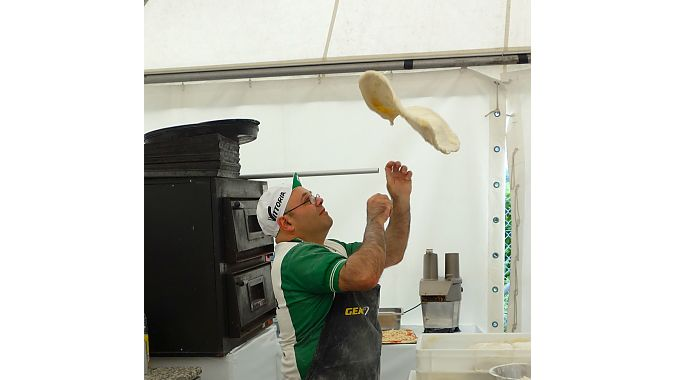 Vittoria tire sponsored a pizza and vino operation at the outdoor demo. This guy could throw dough into a rectangular shape with amazing facility - and a smile.