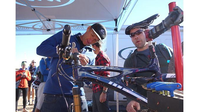 Ibis founder Scot Nicol, left, sets up a bike for Seattle's Todd Denkinger.