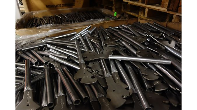 A bin of pedal wrenches mid-production.