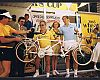 At the 1985 Beverly Hills Celebrity Bike Race, Cohen (center) presents a Kuwahara tandem to race winner Kiki Vandeweghe (far right) of the Los Angeles Lakers. This small tandem was later exchanged for a larger bike to fit the 6-foot-8 Vandeweghe.
