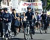 The ride through Hollywood was punctuated by a Veterans Day protest march held by Justice for Filipino American Veterans, which advocates for recognition and just compensation for Filipino World War II veterans and their families.