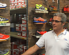 Nico Stasi demonstrates his rolling shoe display and storage shelves, built in-house with recycled materials at No Boundaries Sport.