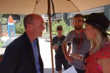 Cox talks to an outdoor industry journalist after the panel discussion.