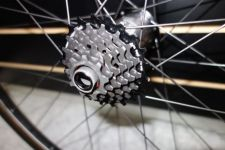 The 9-21 7-speed cassette comes with the wheel.