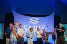 Saris employees of 25 years or more on the stage.