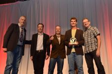 University Bikes of Boulder, Colorado, receives the Retailer of the Year award from presenters Ray Keener and Dan Mann.
