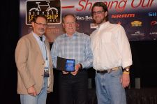 Steve Meineke (center) accepts a BRAINy award.