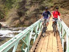 Jet Lites owners Mike Henderson, left, and Jim Scripps take a bridge break near Downieville, California