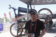 Company founder Joshua Hon keeps cool under the Tern tent at Outdoor Demo.