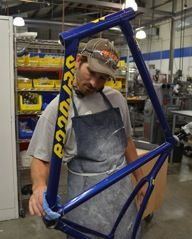 Steven Breault inspects a new Serotta frame on Wednesday. Photo courtesy Serotta.