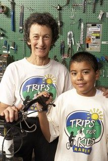 Marilyn Price with a student at the Trips for Kids Re-Cyclery